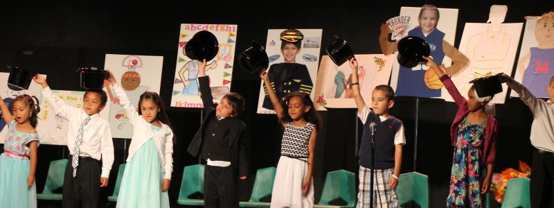 Kindergarten Gradution include performance for their family and friends